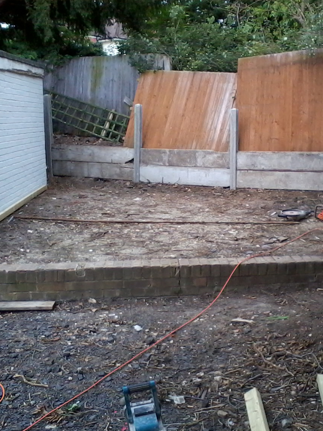 Patio paving fencing decking turfing for Garden decking before and after