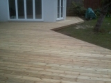 Decking linking pool and room after